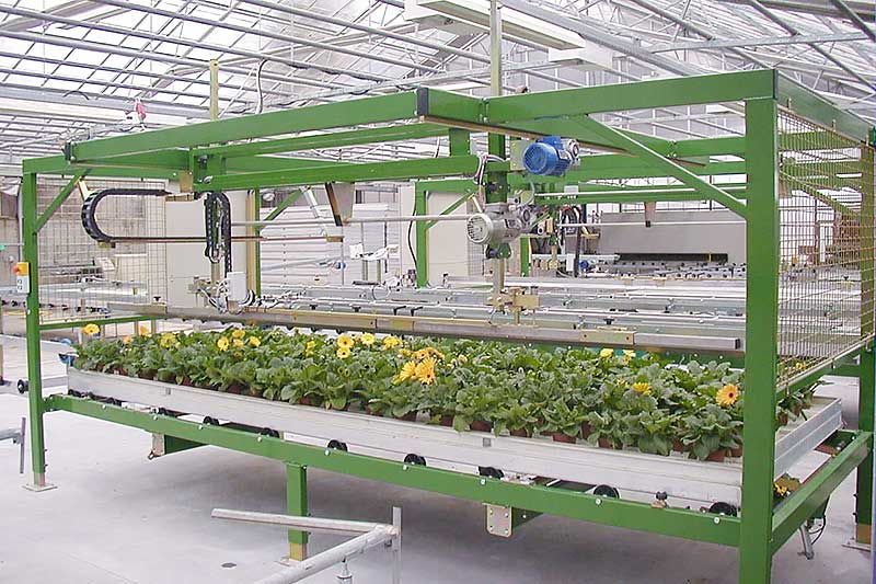 Robots pick up plants and put them down again
